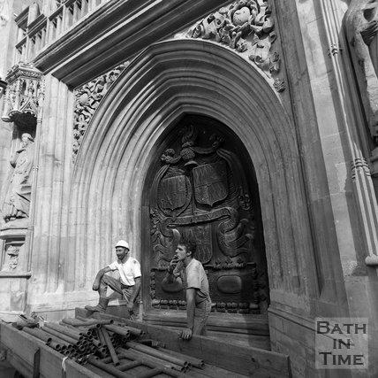 Two scaffolders outside the west door of Bath Abbey, c.1990