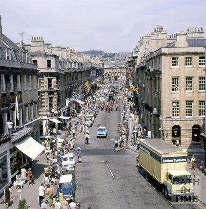 A procession down Milsom Street, led by a Panda Car, 1977