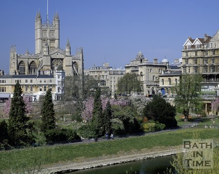 A spring view of Bath Abbey from across the River Avon and Parade Gardens, c.1980