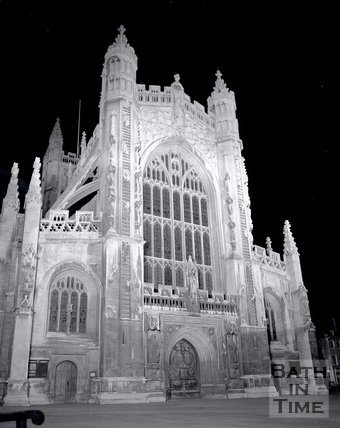 The floodlit west end of Bath Abbey, c.1980