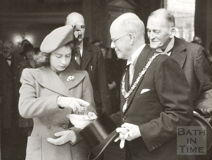 Princess Elizabeth samples the water in the Pump Room with Mayor Clements, Bath 1945