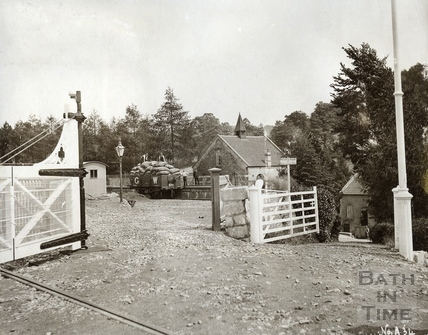 Looking through the level crossing gates, Monkton Combe Station c.1920