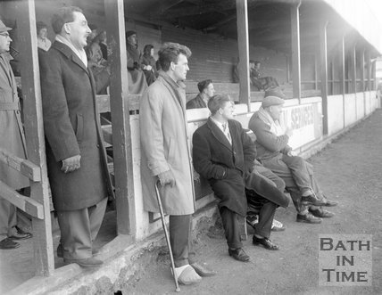 An injured Bath City Football Club star watches the game from the touchline, c.1962