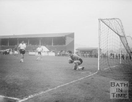 The goalkeeper of the visiting team collects the ball at Twerton Park, c.1963