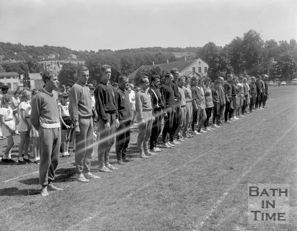 Athletics assemble at the Recreation Ground before a sporting event, c.1963