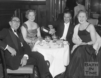 Two couples share a drink at a smart event in Bath, c.1963