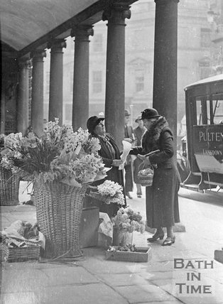 Mrs Davis, flower seller under the colonnade, Stall Street, Bath, c.1940s?