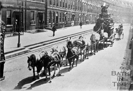 A heavily laden coach pulled by 10 horses on The Paragon, Bath, c.1910?