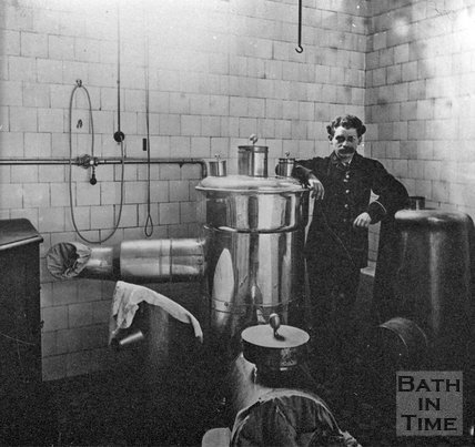 A gentleman posing by a large hot water contraption, Bath, c.1900