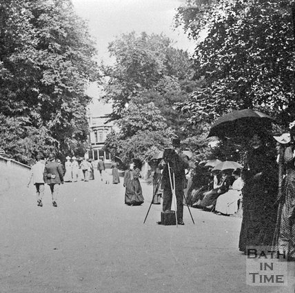 A gentleman photographer and promenaders, Sydney Gardens, Bath, c.1900