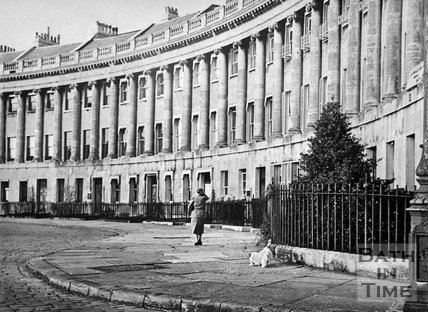 A lady walking her dog on the Royal Crescent, Bath, c.1940s