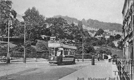 A tram passes Hedgemead Park with Camden Crescent in the background, c.1900