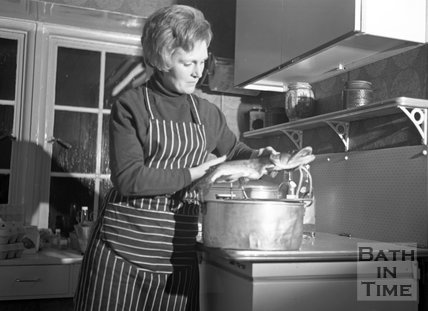 Mary Berry cooking fish at her home in Bath, 4 February 1971