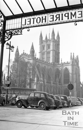 View of Bath Abbey from under the canopy of the Empire Hotel, Orange Grove, Bath, c.1950s