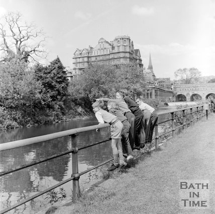 Boys leaning against railings beside the River Avon, Bath, c.1955