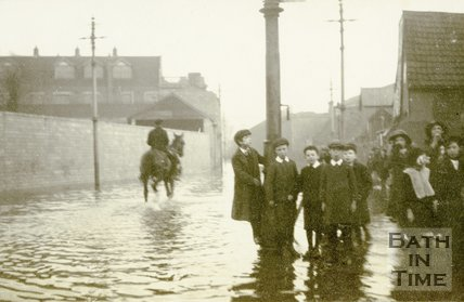 Children on Lower Bristol Road stand beside the flooded road, Bath c.1914