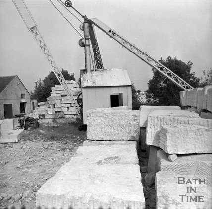 Stacked blocks of Bath Stone and crane at Monks Park mine, near Corsham, 20 September 1973