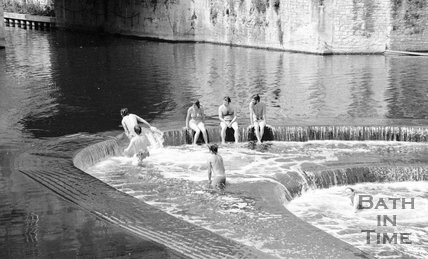 Swimmers at the weir at Pulteney Bridge, Bath, 28 June 1983