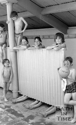 Swimmers by the changing screen at the Cleveland Baths, Bath, 29 May 1978
