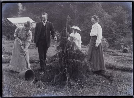 Emily, William and Mary Blathwayt with Mary Howey planting a tree 1910