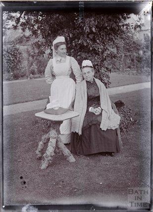 Portrait of two nurses sitting in the garden of Eagle House, Batheaston c.1902