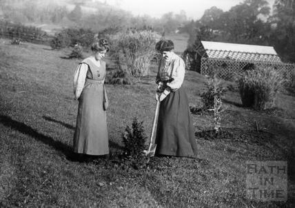 Suffragette Theresa Garnett planting tree with Annie Kenney 7 November 1909