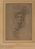 Woman carrying a basket on the head