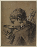 Boy drinking from a bowl