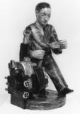 Man Oiling a Machine