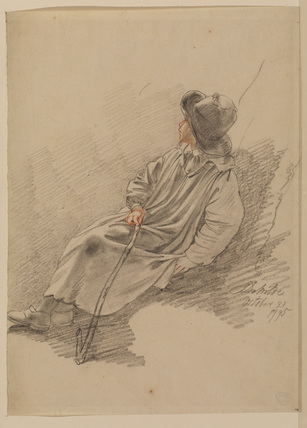 Boy in a smock, seated on a bank