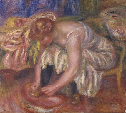 Woman tying her shoe