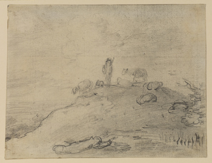 Shepherd and sheep on the crest of a hill