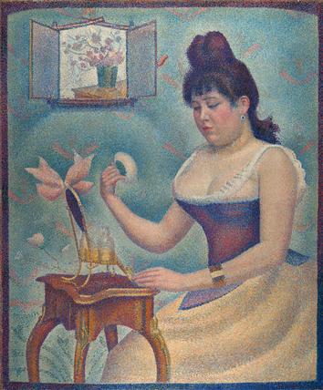 Woman powdering herself