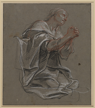 Woman kneeling with her hands clasped