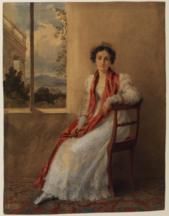 Woman sitting at a window