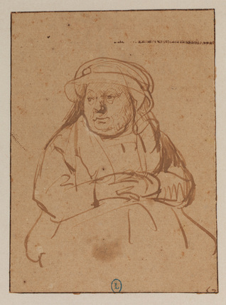 Woman seated with hands clasped on her lap