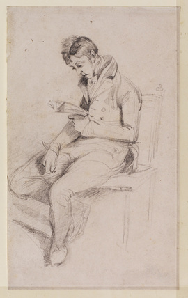 Young man seated, reading