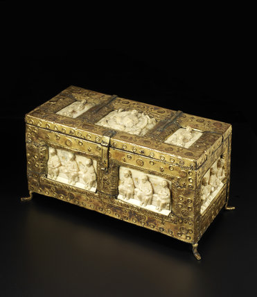 Walrus ivory panels mounted in a gilt copper casket