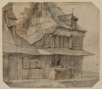 Rear view of a cottage with protective roof and attached well