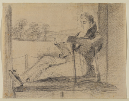 Young man seated at a window, reading