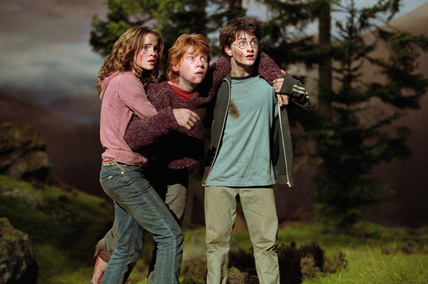 Harry, Ron & Hermione outside in the dark