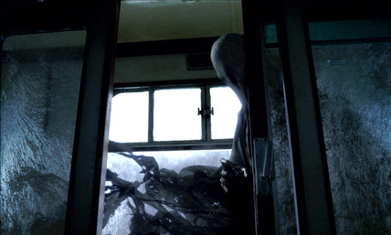 A Dementor entering train carriage
