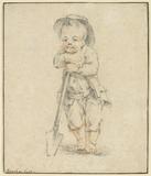 Boy leaning on spade