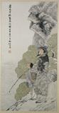 Figure of a man overlooking water