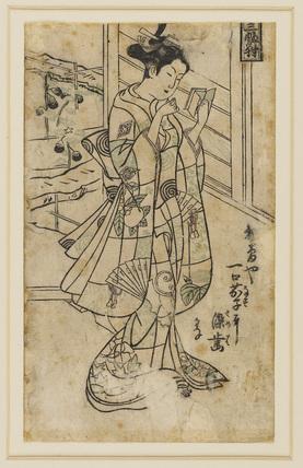 Onoe Kikingoro I as a woman reading a book