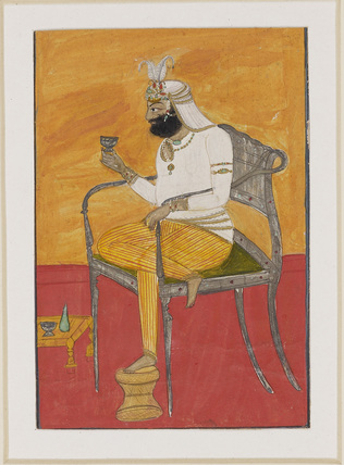 Man seated in European-type chair