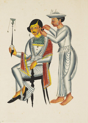 Young Bengali having his ears pierced