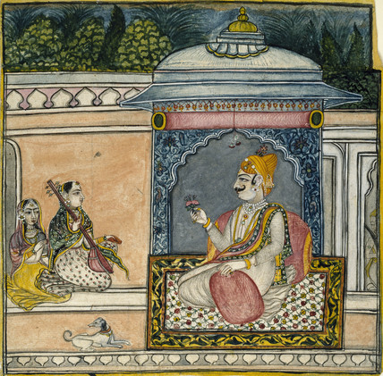A Raja seated on a terrace with two female musicians and a dog