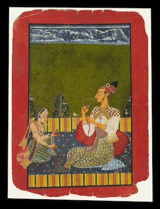 Maharaja Medini Pal smoking a hookah