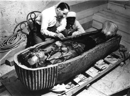Carter examining the innermost coffin of Tutankhamun